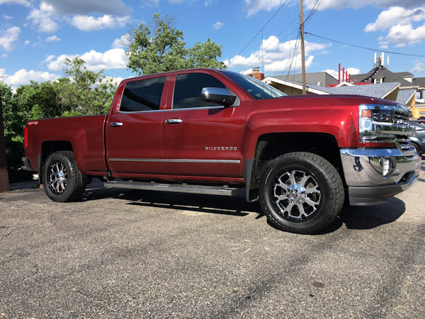 2017 Chevy Silverado 1500 with a Zone Offroad leveling kit and 20 inch XD Buck wheels and 33 inch Radar AT5 tires