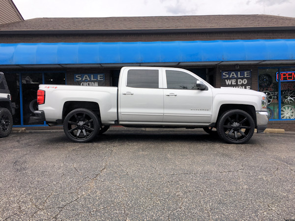 2016 Chevy Silverado 1500 with 24 inch KMC Slide wheels and 285/40/24 Atturo tires