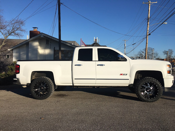 2015 Chevy Silverado 1500 with Rough Country 3.5 inch lift kit with 20x10 inch American Truxx AT162 Vortex wheels and 33 inch Atturo Trail Blade MT tires