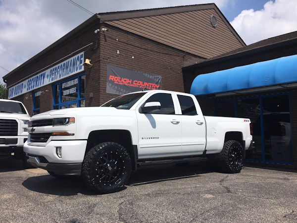 2016 Chevy Silverado 1500 with a 3 inch Rough Country lift kit and 20x9 KMC XD Grenade wheels and 33 inch Nitto Trail Grappler tires