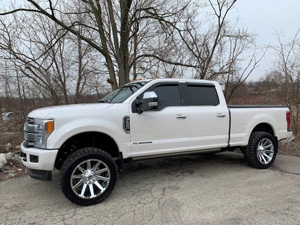 2019 F250 Platinum, with a Rough Country leveling kit,22x10 Fuel Contra and 35x12.50x22 Radar R7 M/T's