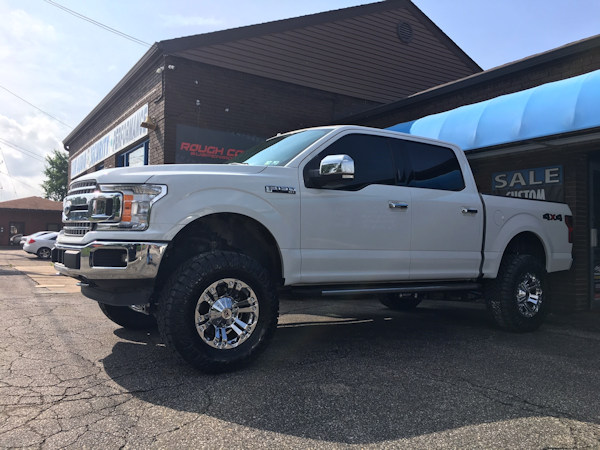 Ford Superduty with Rough Country leveling kit and 18x9 XD Monster wheels and 35 in Nitto Ridge Grappler tires