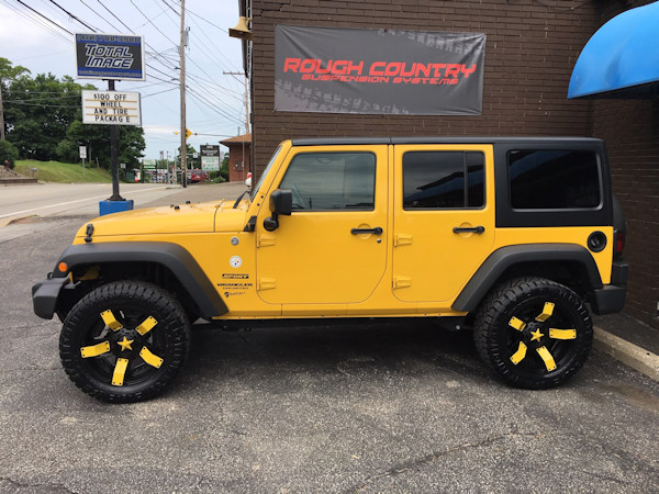 Jeep Wrangler with 2 inch Teraflex lift kit and 20x9 Rockstar 2 wheels and 33 inch Nitto Ridge Grappler tires
