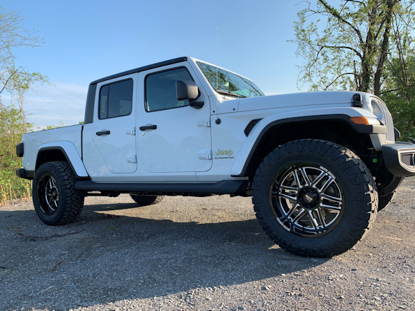 2020 Jeep Gladiator, with 2.5in Rough Country leveling kit, 20x10 Motto Folsom and 35x12.50x20 Nitto Ridge Grapplers