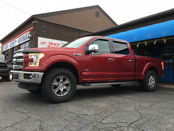 2015 Ford F-150 with front leveling kit, Bushwacker pocket style fender flares and 35x12.50x18 Atturo Trail Blade MT tires