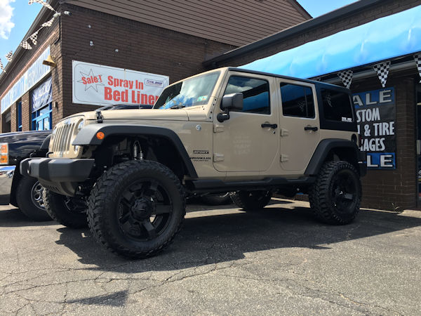 2016 Jeep Wrangler with a 4 inch lift and 20x9 KMC XD Rockstar II wheels and 35 inch Mastercrsft MXT tires