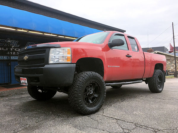 2008 Chevy Silverado with a 6.5 inch Zone Offroad lift kit and 20x9 KMC XD Rockstar 3 wheels with 35 inch Nitto Ridge Grappler tires