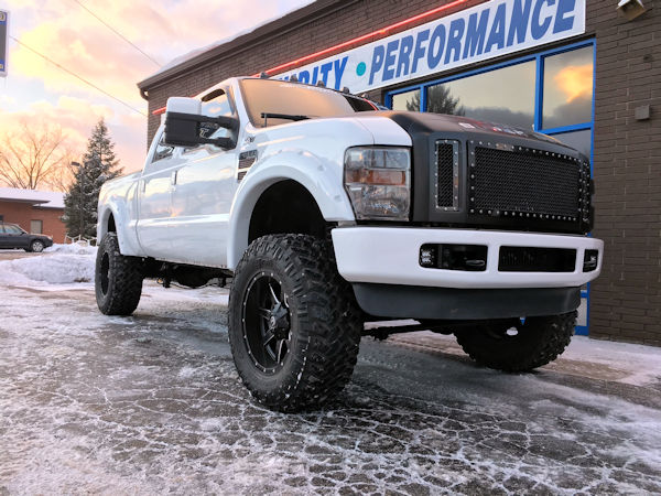 2008 Ford F-250 with 6 inch Zone Offroad lift kit and 20x10 Fuel Offroad Maverick wheels with 38 inch Nitto Trail Grappler tires.  3M satin black vinyl wrapped on grille, hood, rood, and tailgate.