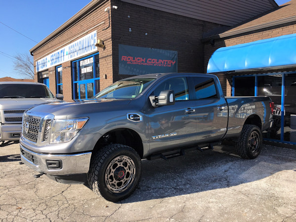 2017 Nissan Titan XD with a 3 inch Rough Country lift kit and 20x9 XD837 wheels with Toyo Open Country AT2 tires 305/55/20