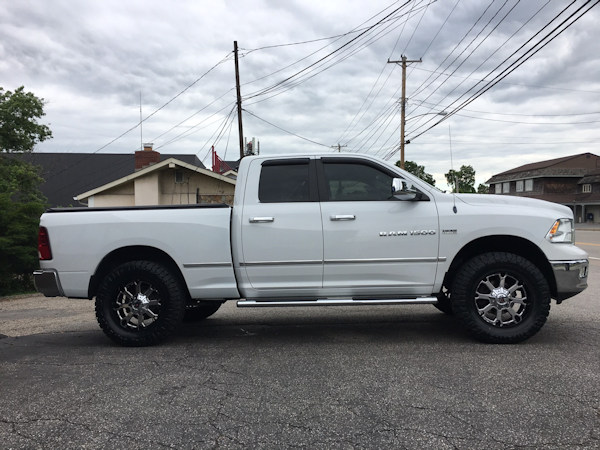 2012 Ram 1500 with Bilstein 5100 adj. front struts and Daystar 1.5 inch rear coil spacers and 20 inch XD Buck wheels with 35 inch Nitto Ridge Grappler tires