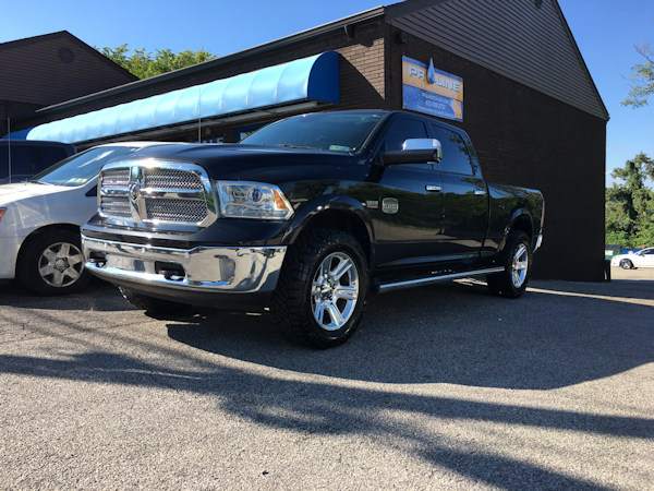 Ram 1500 with Bilstein 5100 front shocks and 295/60/20 Nitto Ridge Grappler tire