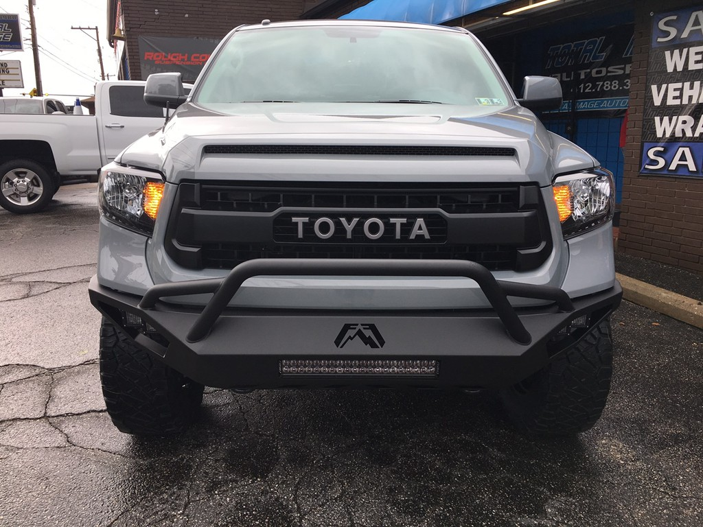 Toyota photo gallerytotal image auto sport pittsburgh pa 2017 toyota tundra trd pro with 4 inch readylift lift with 20 inch fuel vapor wheels and 35 inch nitto ridge grappler tires fab fours vegance front bumper aloadofball Images