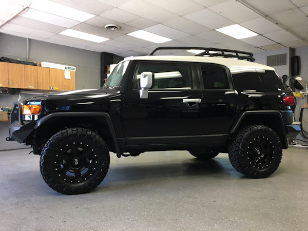 2013 Toyota FJ Cruiser with a Readylift SST lift kit with 18 inch XD Fusion wheels and 33 inch Nitto Ridge Grappler tires and Warrior Products front and rear bumper